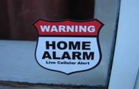 Home Alarm Services sign