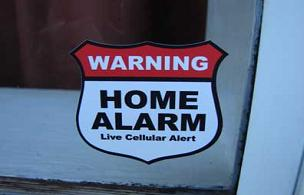 A home alarm system and alarm signs will help keep the criminals away